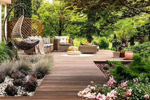istock Wooden terrace surrounded by greenery 957245348