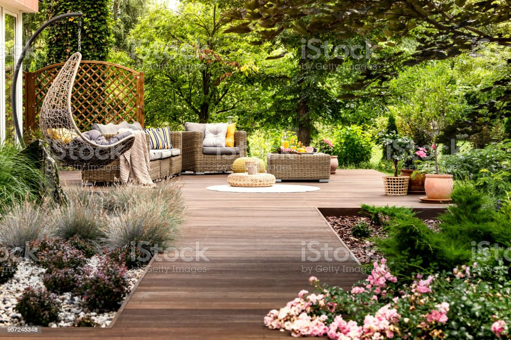 Wooden terrace surrounded by greenery stock photo