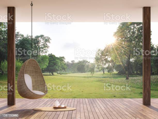 Photo of Wooden terrace with morning garden view 3d render