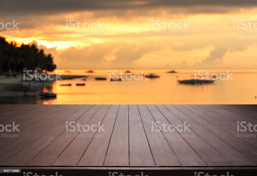 Wooden Terrace With Sunset Beach Background Stock Photo