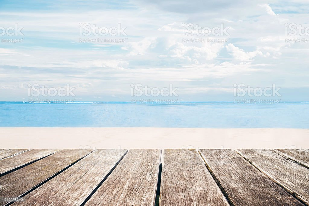 Wooden terrace with the beach view in summer stock photo