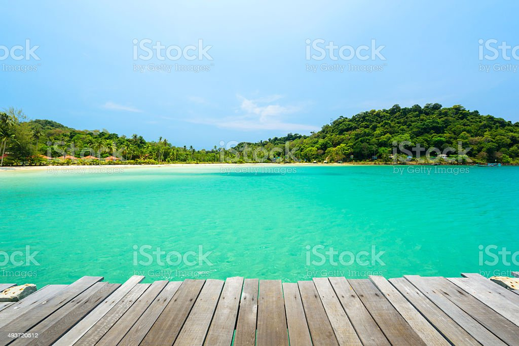 Wooden terrace with the beautiful beach stock photo