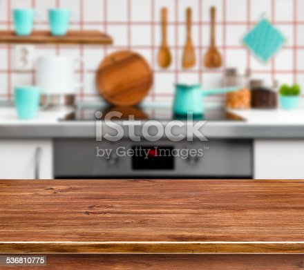 istock Wooden texture table on defocused modern kitchen background 536810775