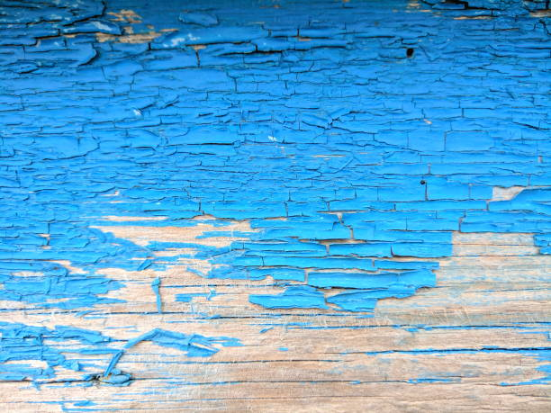 wooden texture with cracked blue paint, old pattern with shabby paint, cracked blue surface, abstract background for the designer, blank for the designer, vintage style - peeled stock photos and pictures