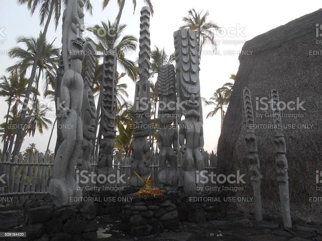 Wooden Tiki Statues at Puuhonua o Honaunau National Historical Park. stock photo