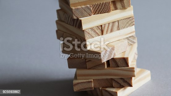 istock A wooden tower mounting anxiously. 925593862