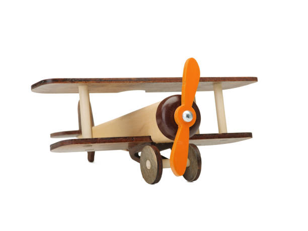 hölzernes spielzeugflugzeug isoliert auf weiss. holz kinderspielzeug. ökologie. - holzspielwaren stock-fotos und bilder