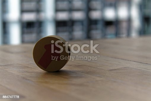 istock Wooden toy arrow on the circle on the table. 884747778