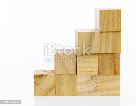 173937666istockphoto Wooden toy block stairs on white background 1132264206