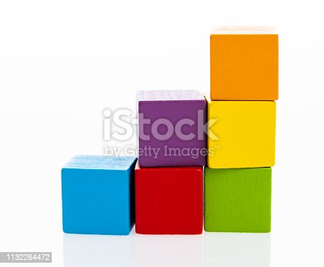 173937666istockphoto Wooden toy block stairs on white background 1132264472