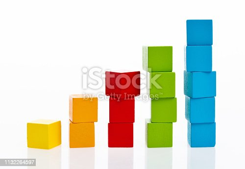 173937666istockphoto Wooden toy block stairs on white background 1132264597