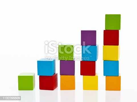 istock Wooden toy block stairs on white background 1132265509