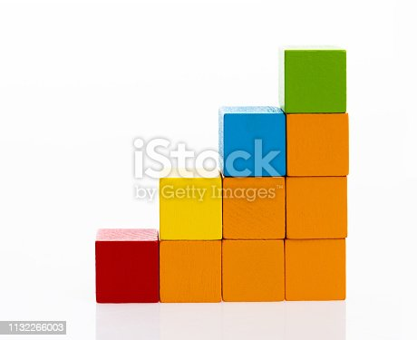 173937666istockphoto Wooden toy block stairs on white background 1132266003