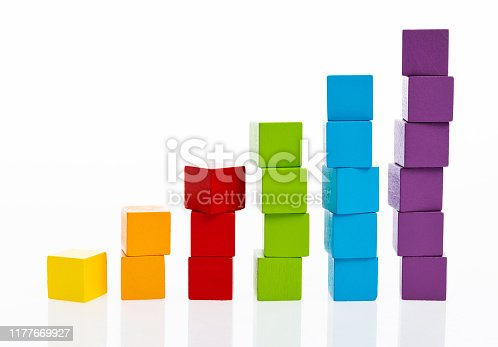 173937666istockphoto Wooden toy block stairs on white background 1177669927
