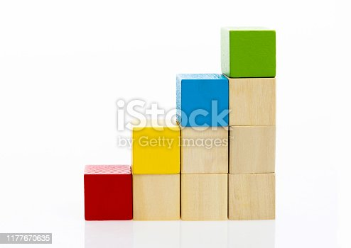 173937666istockphoto Wooden toy block stairs on white background 1177670635