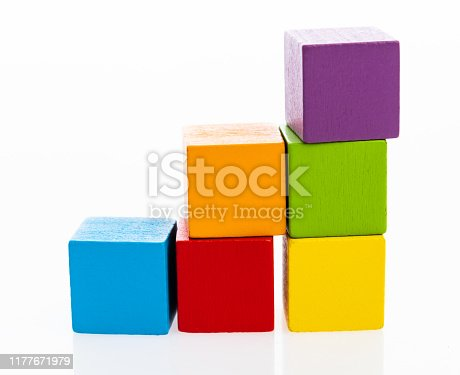 173937666istockphoto Wooden toy block stairs on white background 1177671979