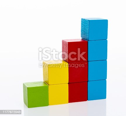 173937666istockphoto Wooden toy block stairs on white background 1177672043