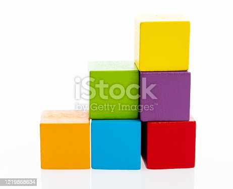 173937666 istock photo Wooden toy block stairs on white background 1219868634