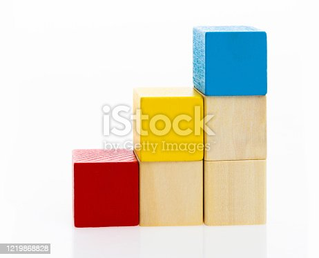 173937666 istock photo Wooden toy block stairs on white background 1219868828