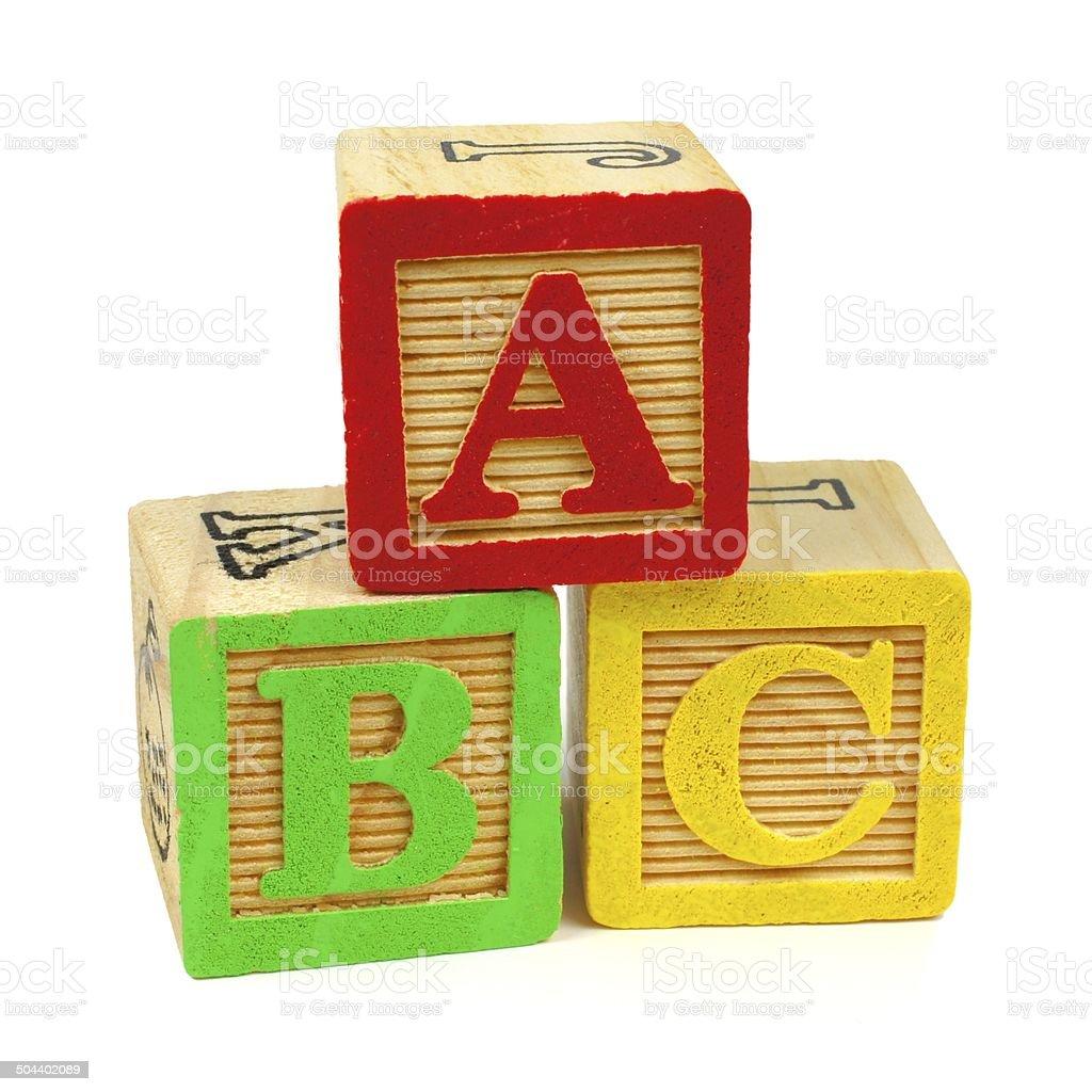 ABC wooden toy blocks on white stock photo