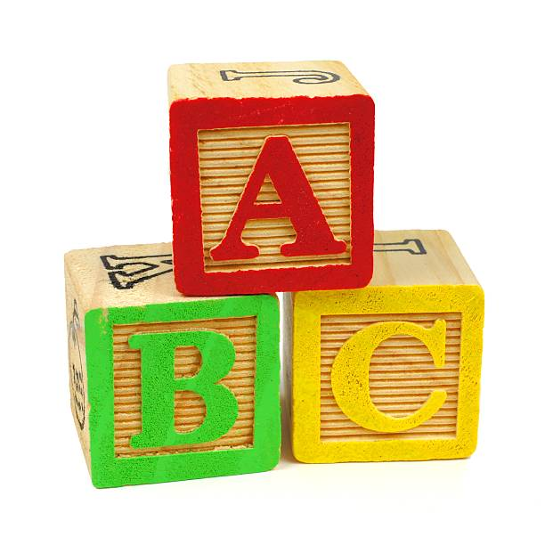 abc wooden toy blocks on white - alphabetical order stock pictures, royalty-free photos & images