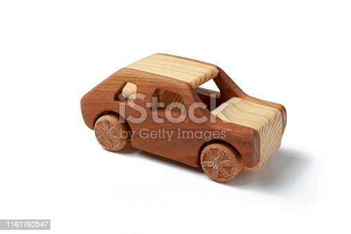 Wooden children's toy car on a white background