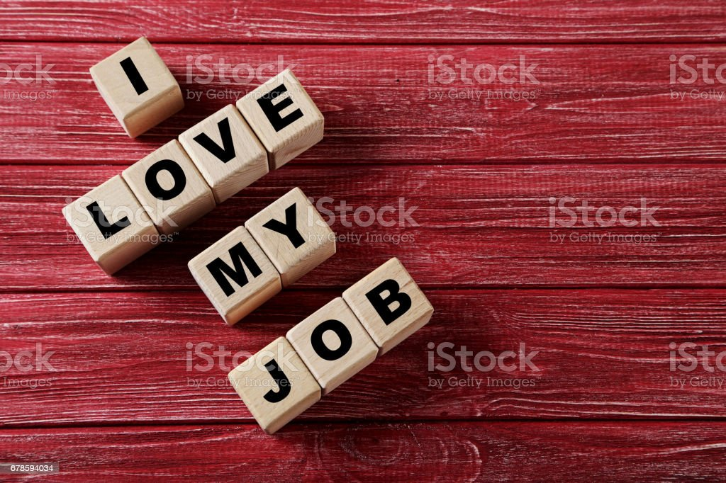 Wooden Toy Cubes With Word I Love My Job On A Red Wooden Table Stock