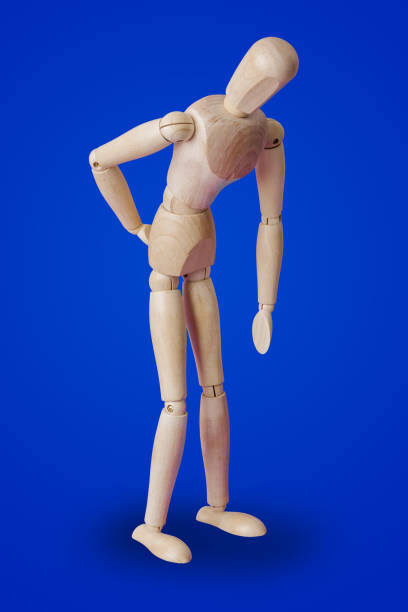 Holzspielzeugfigur des Patienten - medizinisches Konzept – Foto