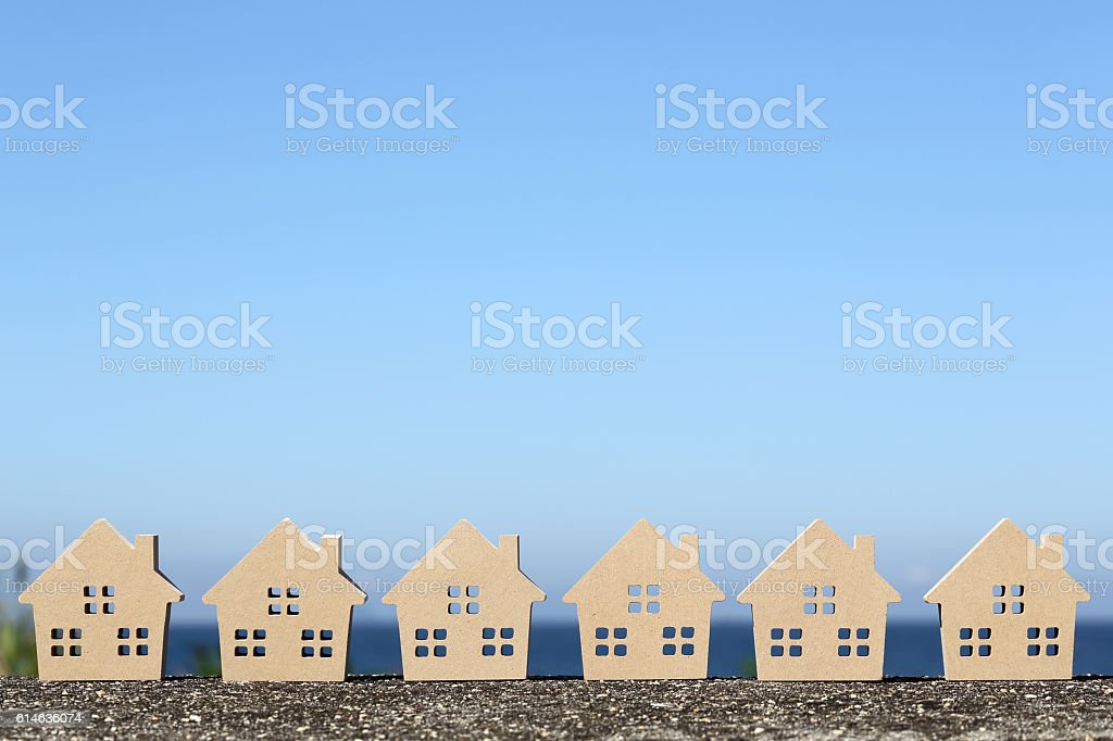 wooden toy house against blue sky stock photo