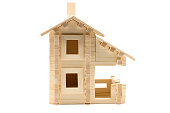 Wooden toy house isolated on white