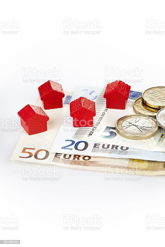 Wooden toy houses and european currency royalty-free stock photo