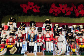 Wooden toy nutcrackers on the shelf of craft Christmas shop