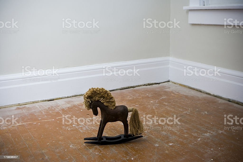 Wooden Toy Rocking Horse on Floor royalty-free stock photo