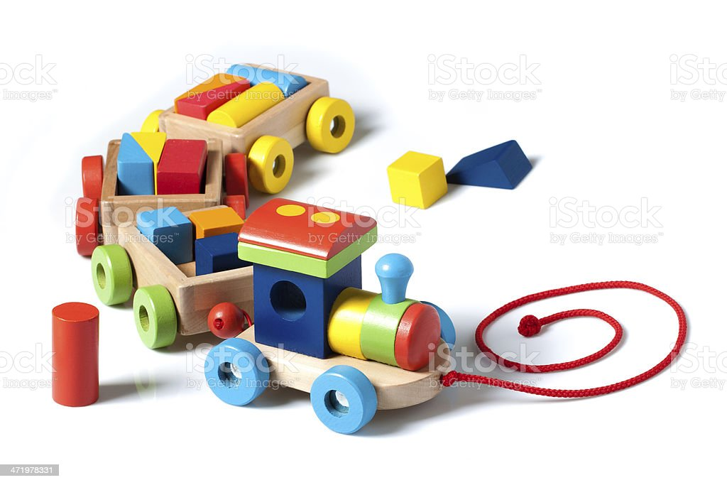 Wooden toy train on white stock photo