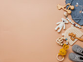 istock Wooden toys, clothes and shoes on beige background 1208543122