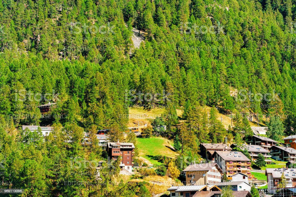 Wooden traditional Swiss chalets in mountains of Zermatt town CH royalty-free stock photo