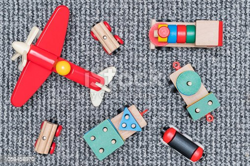 children wooden toys model trains and aircraft on the carpet