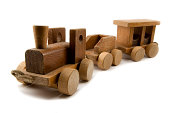 Wide angle shot of a wooden toy train, islolated on white.