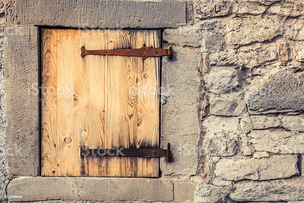 Wooden trap door with rusty hinges stock photo