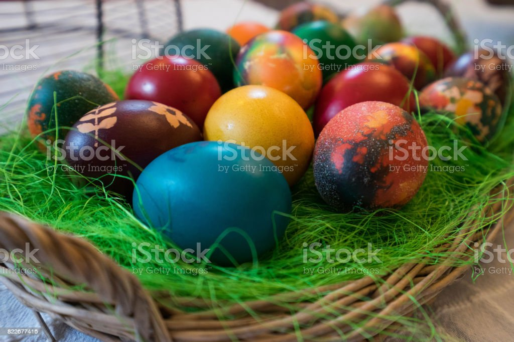 A wooden tray arranged with Easter eggs stock photo