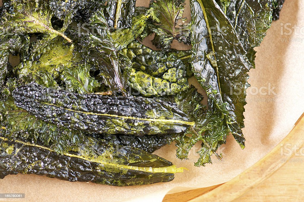 Wooden Tray of Homemade Kale Chips from Above stock photo