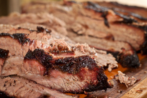 Sliced up smoked Texas style brisket. Shallow depth of field.