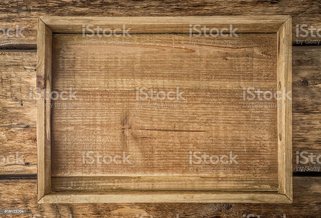 Wooden tray on the wooden table top view stock photo
