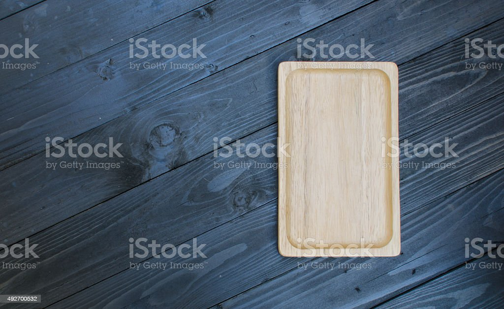 wooden tray on wooden blackground stock photo