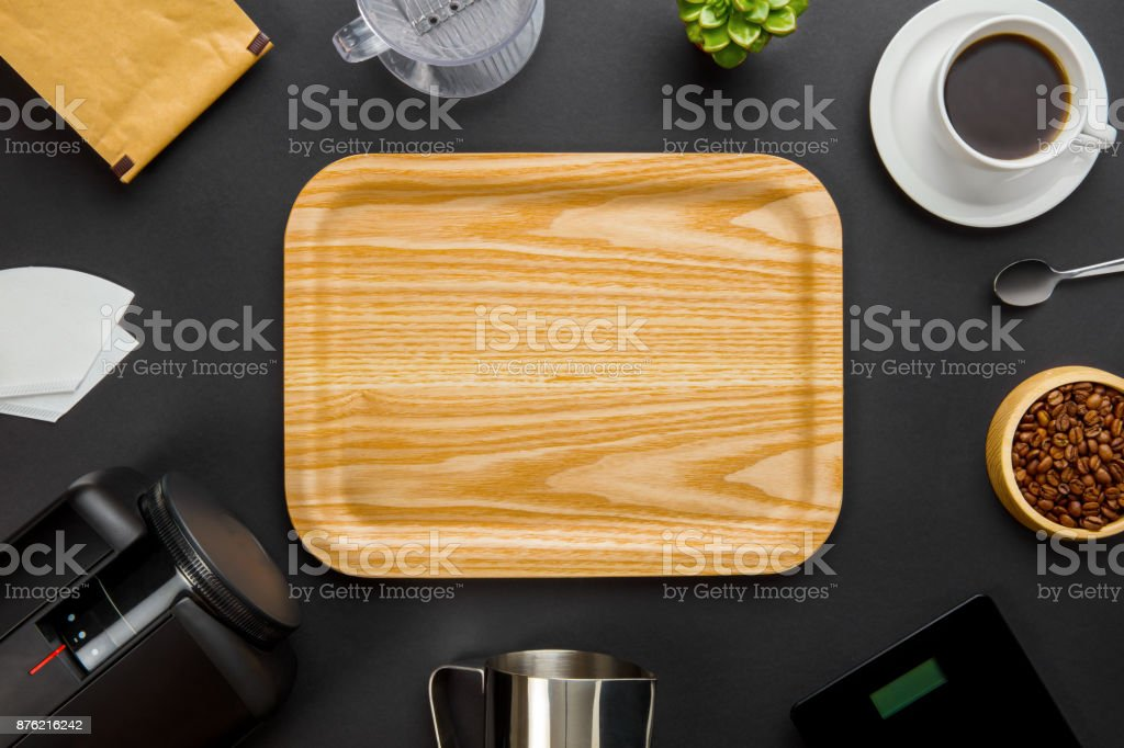 Wooden Tray Surrounded By Coffee Making Equipment On Gray Backgr stock photo