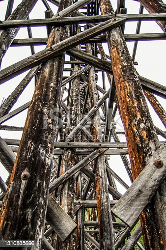 An abandoned bridge creates an artistic display of the past. Located in Interior Alaska this old railroad bridge once brought miners and supplies to their destination. Now abandoned its artistic merit and structural designs continues.
