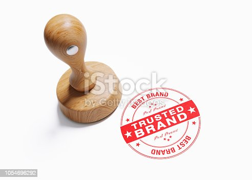 Wooden trusted brand stamp on white background. Horizontal composition with clipping path  and  copy space. High angle view.