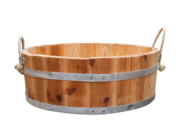 Wooden tub with handle rope Flat wooden tub held by two steel hoops with hemp ropes as a handle isolated on white. trough stock pictures, royalty-free photos & images