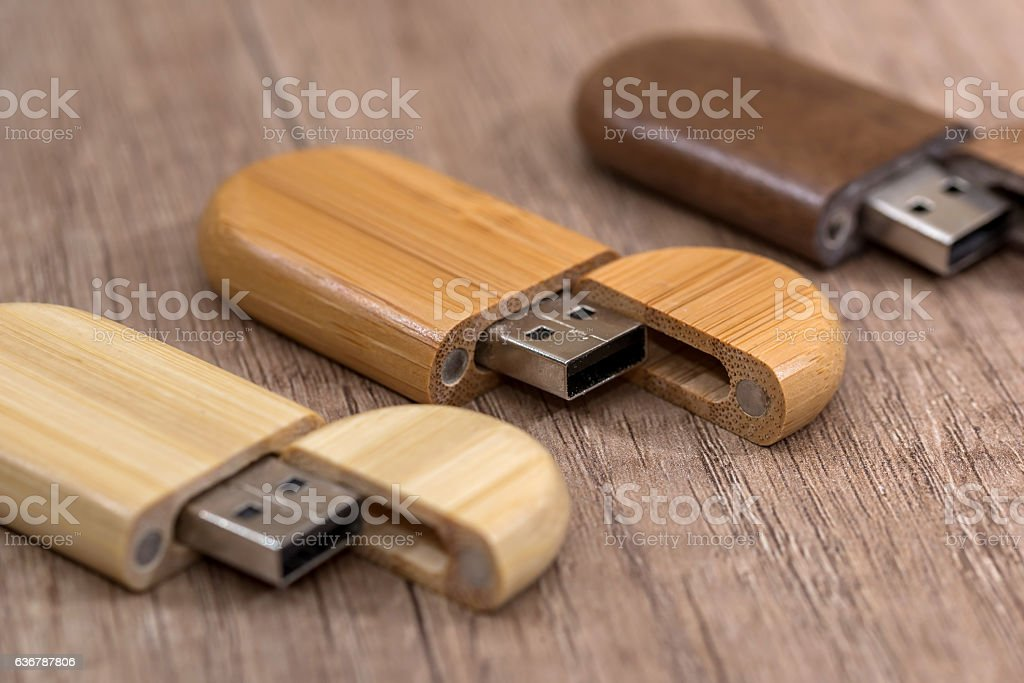 wooden usb flash drive on desk stock photo