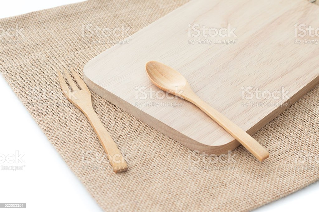Wooden utensils (spoon, fork, wood plate) stock photo